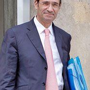 Sarkozy hält an Woerth fest
