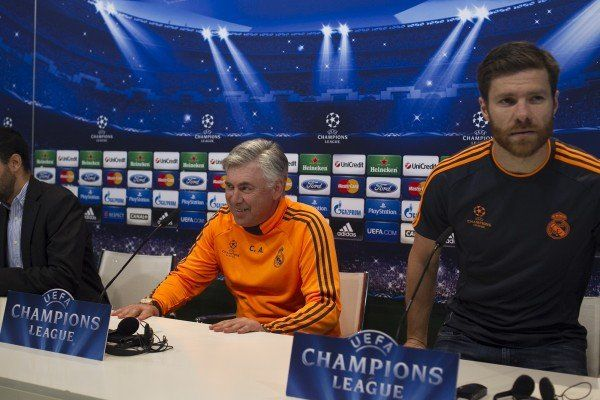 Real's coach Carlo Ancelotti, left, and player Xabi Alonso arrive for a press conference after a training session in Madrid, Spain, Tuesday, April 22, 2014. Real Madrid will face Bayern Munich in a first leg semifinal Champions League soccer match on Wednesday. (AP Photo/Gabriel Pecot)