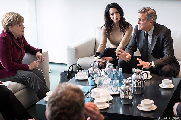 Ehepaar Clooney trifft Angela Merkel