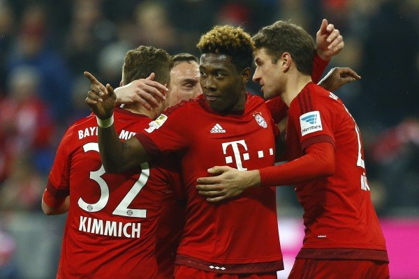 Bayern's Thomas Mueller, right, celebrates with teammates Joshua Kimmich, left, Franck Ribery, background, and David Alaba after scoring his side's third goal during the German Bundesliga soccer match between FC Bayern Munich and SV Werder Bremen at the Allianz Arena stadium in Munich, Germany, Saturday, March 12, 2016. (AP Photo/Matthias Schrader)