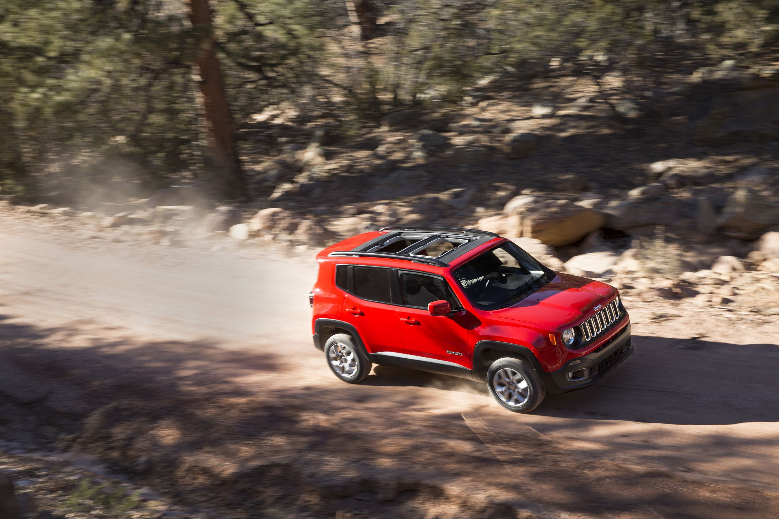 FILE - This file photo provided by Chrysler Group LLC shows the all-new 2015 Jeep Renegade. It looks like a classic Jeep with a vertical grille and round headlamps. (AP Photo/Chrysler Group LLC, file)